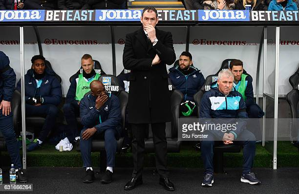 Paul Clement manager of Swansea City looks on from the bench alongside new assistant Claude Makelele prior to the Premier League match between...