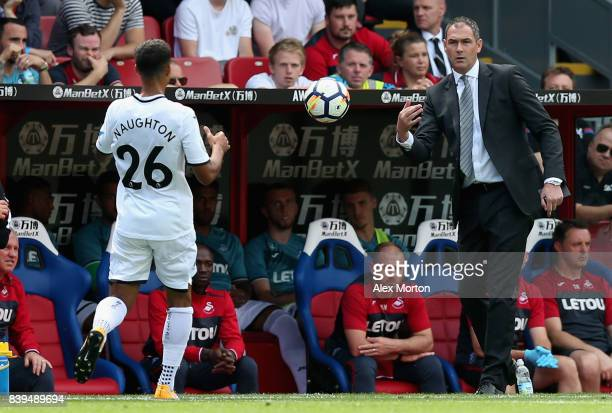 Paul Clement Manager of Swansea City throws the ball to Kyle Naughton of Swansea City during the Premier League match between Crystal Palace and...