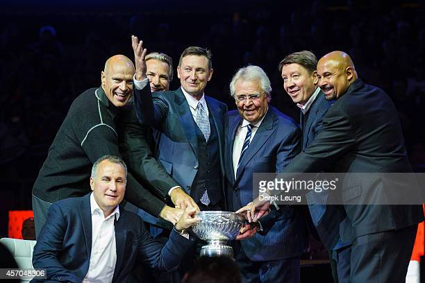 Paul Coffey Mark Messier Glenn Anderson Wayne Gretzky Glen Sather Jari Kurri and Grant Fuhr pose with the Stanley Cup during the Edmonton Oilers...