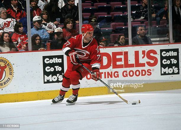 Paul Coffey of the Carolina Hurricanes skates with the puck during an NHL game against the New Jersey Devils on February 13 1999 at the Continental...