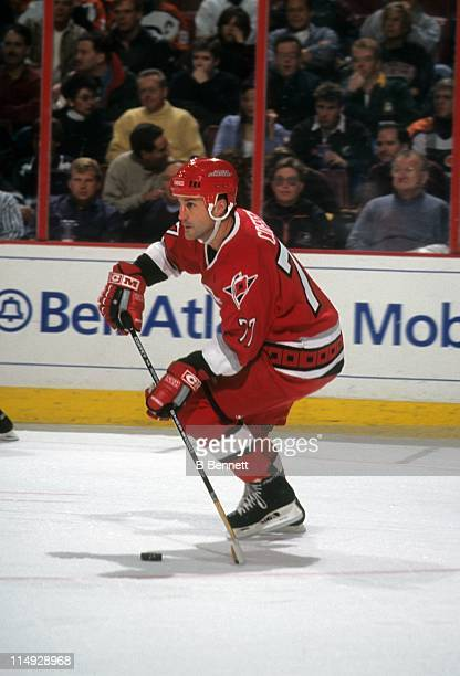Paul Coffey of the Carolina Hurricanes skates with the puck during an NHL game against the Philadelphia Flyers on December 9 1999 at the First Union...