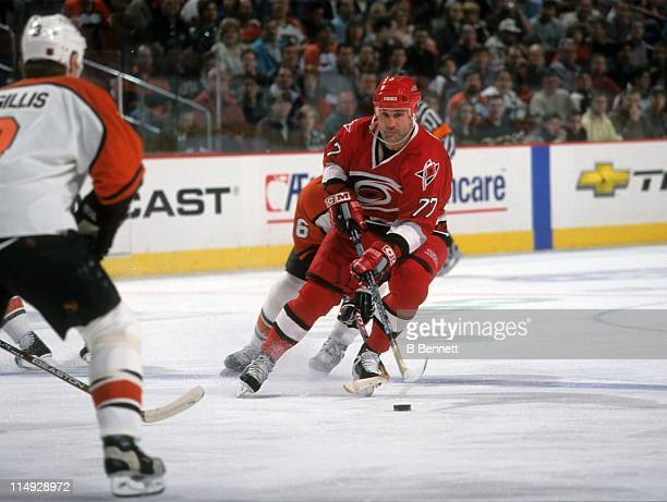 Paul Coffey of the Carolina Hurricanes skates with the puck during an NHL game against the Philadelphia Flyers on March 30 1999 at the First Union...