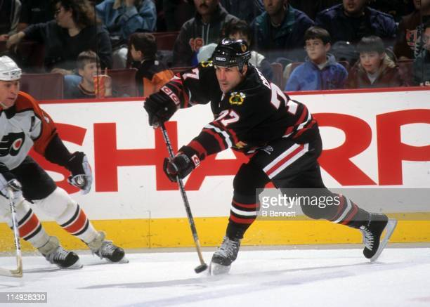 Paul Coffey of the Chicago Blackhawks passes the puck during an NHL game against the Philadelphia Flyers on December 19 1998 at the First Union...