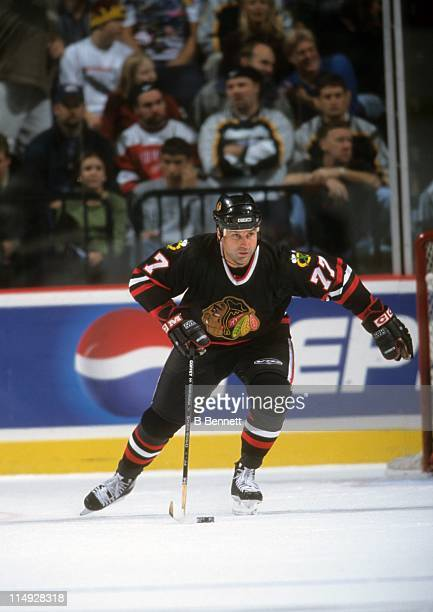 Paul Coffey of the Chicago Blackhawks skates with the puck during an NHL game against the Nashville Predators on November 17 1998 at the Nashville...