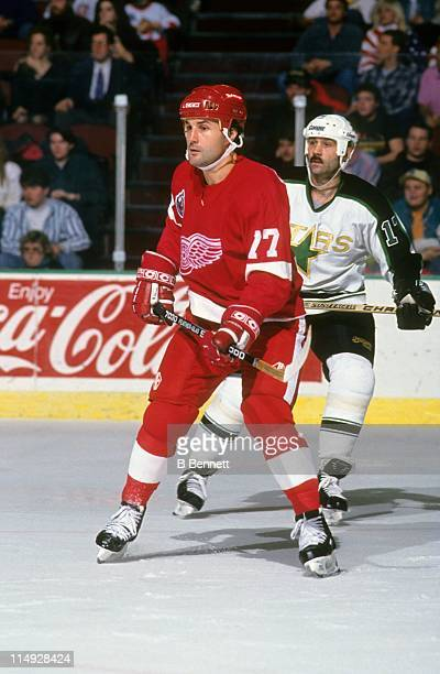 Paul Coffey of the Detroit Red Wings looks for the pass as Mike McPhee of the Dallas Stars defends during their game on April 14 1994 at the Reunion...
