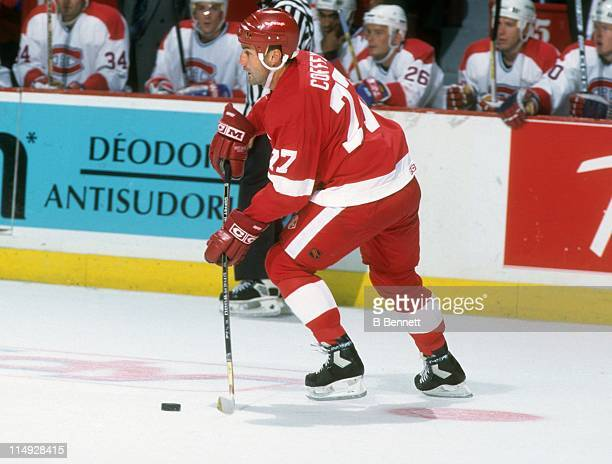 Paul Coffey of the Detroit Red Wings skates with the puck during an NHL game against the Montreal Canadiens circa 1993 at the Montreal Forum in...