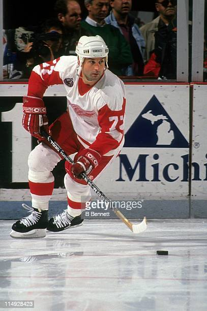 Paul Coffey of the Detroit Red Wings skates with the puck during an NHL game circa 1995 at the Joe Louis Arena in Detroit Michigan