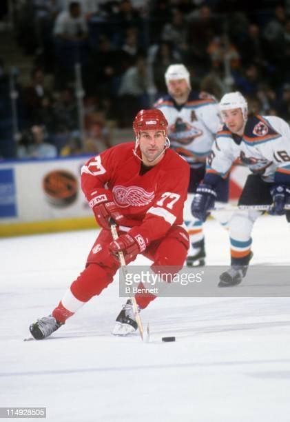 Paul Coffey of the Detroit Red Wings skates with the puck during an NHL game against the New York Islanders circa 1995 at the Nassau Coliseum in...
