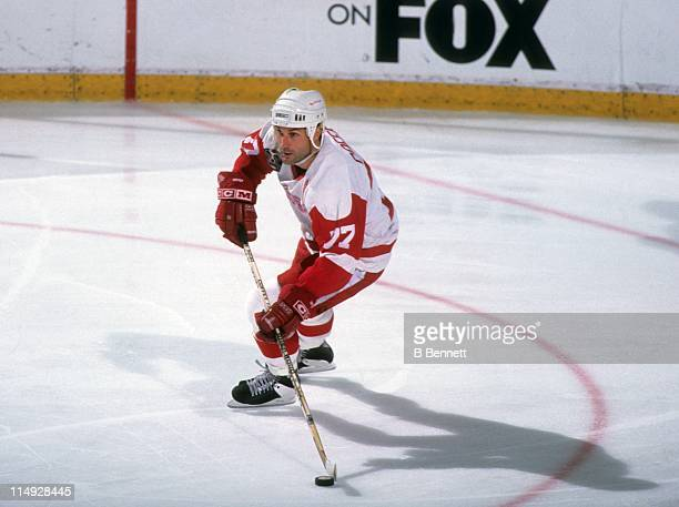 Paul Coffey of the Detroit Red Wings skates with the puck during Game 1 of the 1995 Stanley Cup Finals against the New Jersey Devils on June 17 1995...