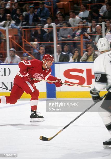 Paul Coffey of the Detroit Red Wings takes the slapshot during an NHL game against the Los Angeles Kings on November 14 1995 at the Great Western...