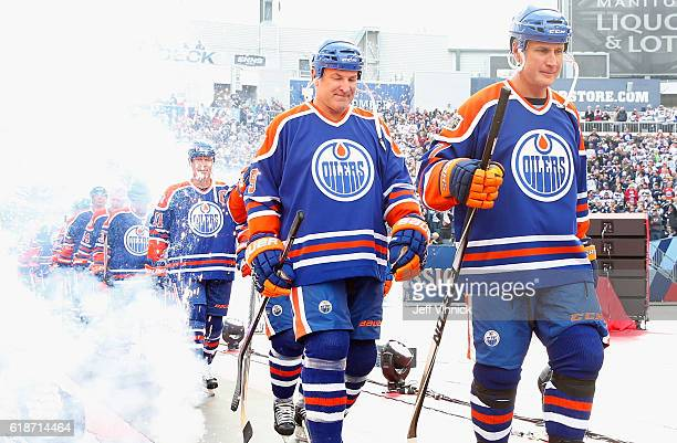 Paul Coffey of the Edmonton Oilers alumni makes his way to the rink ahead of teammate Glenn Anderson to play in the 2016 Tim Hortons NHL Heritage...