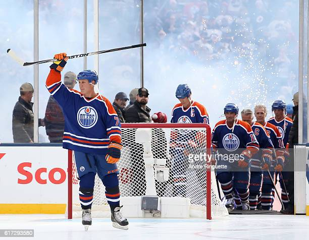 Paul Coffey of the Edmonton Oilers alumni waves to the crowd during the 2016 Tim Hortons NHL Heritage Classic alumni game at Investors Group Field on...