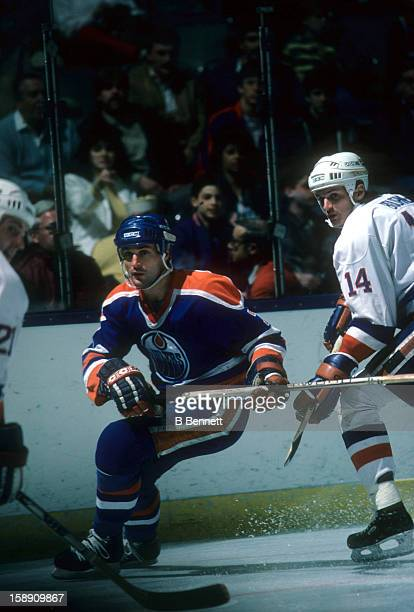 Paul Coffey of the Edmonton Oilers defends during an NHL game against the New York Islanders on March 29 1986 at the Nassau Coliseum in Uniondale New...