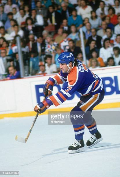 Paul Coffey of the Edmonton Oilers passes the puck during an NHL game against the Philadelphia Flyers circa 1983 at the Spectrum in Philadelphia...