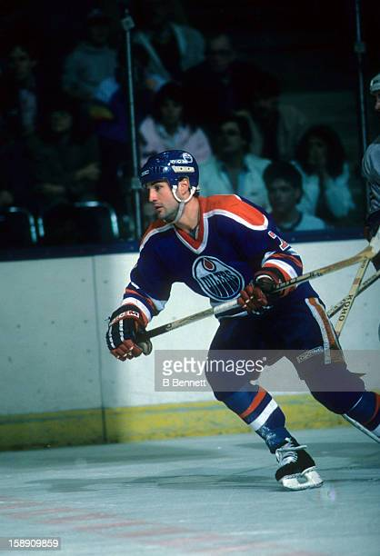 Paul Coffey of the Edmonton Oilers skates on the ice during an NHL game against the New York Islanders on March 29 1986 at the Nassau Coliseum in...