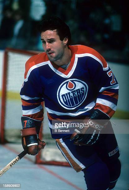 Paul Coffey of the Edmonton Oilers skates on the ice during warmups before an NHL game against the New York Islanders on November 16 1985 at the...