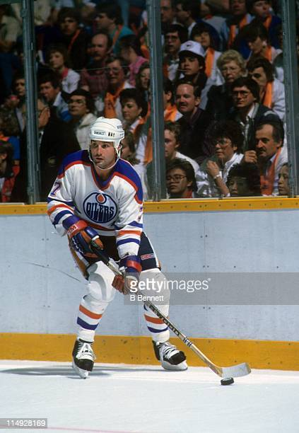 Paul Coffey of the Edmonton Oilers skates with the puck during an NHL game circa 1983 at the Northlands Coliseum in Edmonton Alberta Canada
