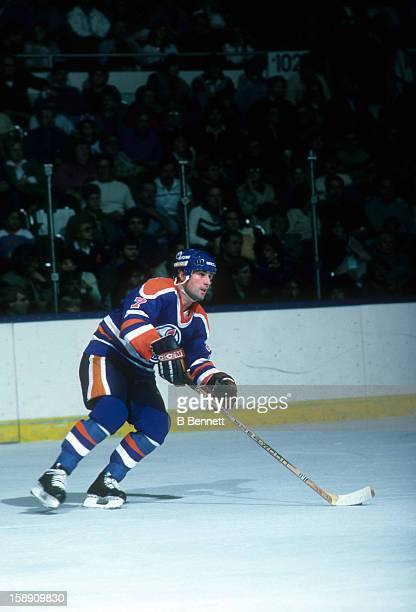 Paul Coffey of the Edmonton Oilers skates with the puck during an NHL game against the New York Islanders on November 16 1985 at the Nassau Coliseum...