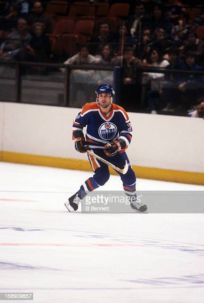 Paul Coffey of the Edmonton Oilers skates with the puck during an NHL game against the New York Rangers on November 17 1985 at the Madison Square...