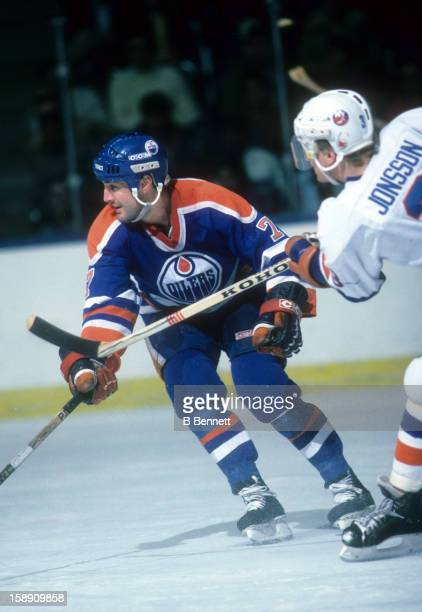 Paul Coffey of the Edmonton Oilers tries to block a pass from Tomas Jonsson of the New York Islanders on March 29 1986 at the Nassau Coliseum in...