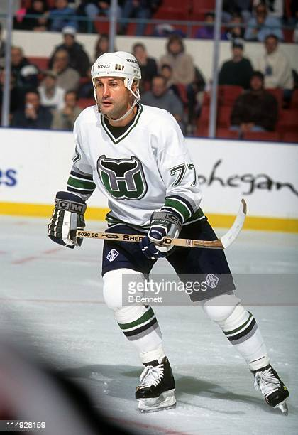 Paul Coffey of the Hartford Whalers skates on the ice during an NHL game in December 1996 at the Hartford Civic Center in Hartford Connecticut