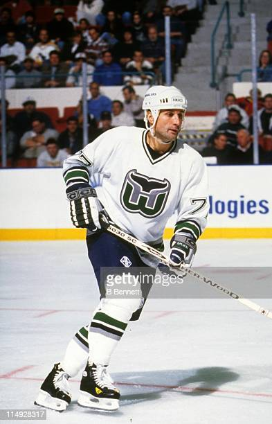 Paul Coffey of the Hartford Whalers skates on the ice during an NHL game in November 1996 at the Hartford Civic Center in Hartford Connecticut