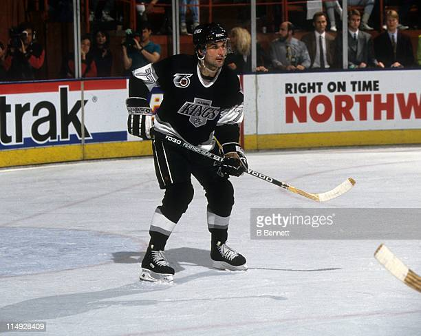 Paul Coffey of the Los Angeles Kings skates on the ice during an NHL game circa 1992 at the Great Western Forum in Inglewood California