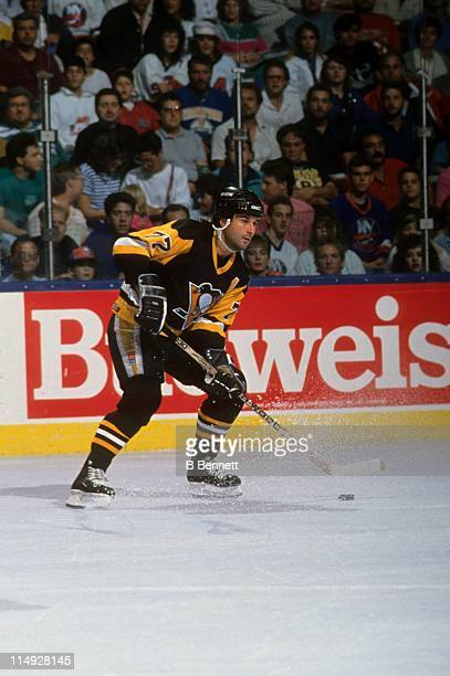 Paul Coffey of the Pittsburgh Penguins looks to pass the puck during an NHL game against the New York Islanders on October 13 1990 at the Nassau...