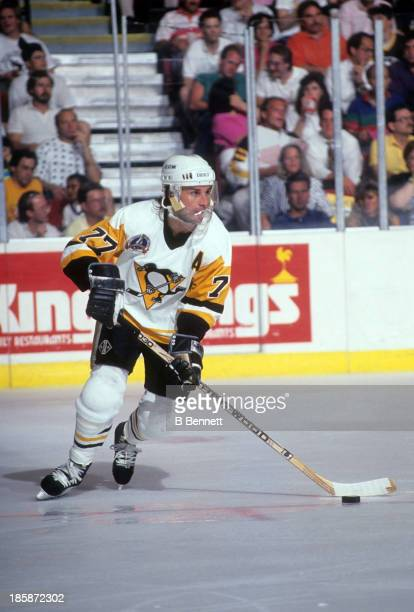 Paul Coffey of the Pittsburgh Penguins skates with the puck during Game 2 of the 1991 Stanley Cup Finals against the Minnesota North Stars on May 17...