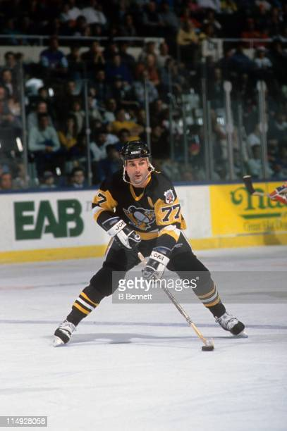 Paul Coffey of the Pittsburgh Penguins skates with the puck during an NHL game against the New York Islanders circa 1992 at the Nassau Coliseum in...
