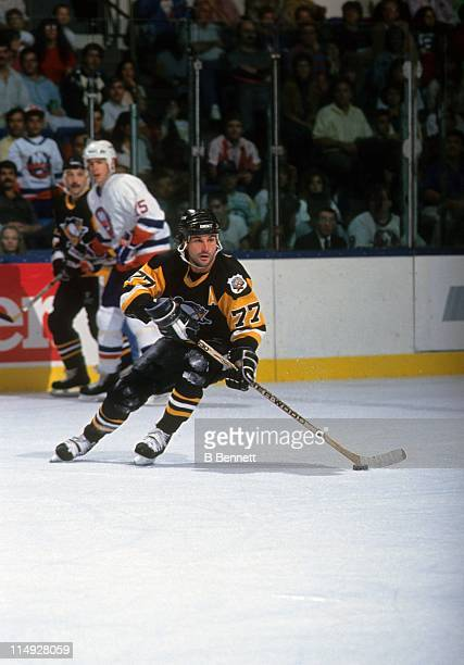 Paul Coffey of the Pittsburgh Penguins skates with the puck during an NHL game against the New York Islanders circa 1991 at the Nassau Coliseum in...