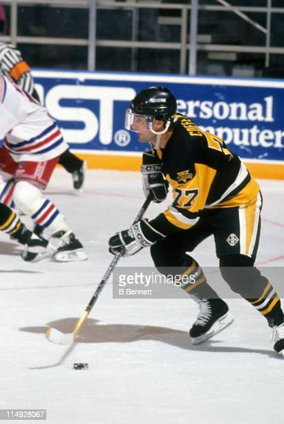 Paul Coffey of the Pittsburgh Penguins skates with the puck during an NHL game against the New York Rangers on December 29 1991 at the Madison Square...