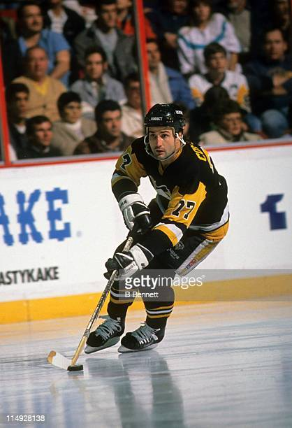 Paul Coffey of the Pittsburgh Penguins skates with the puck during an NHL game in December 1992
