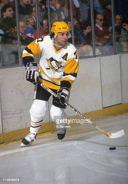 Paul Coffey of the Pittsburgh Penguins skates with the puck during an NHL game in December 1988 at the Mellon Arena in Pittsburgh Pennsylvania