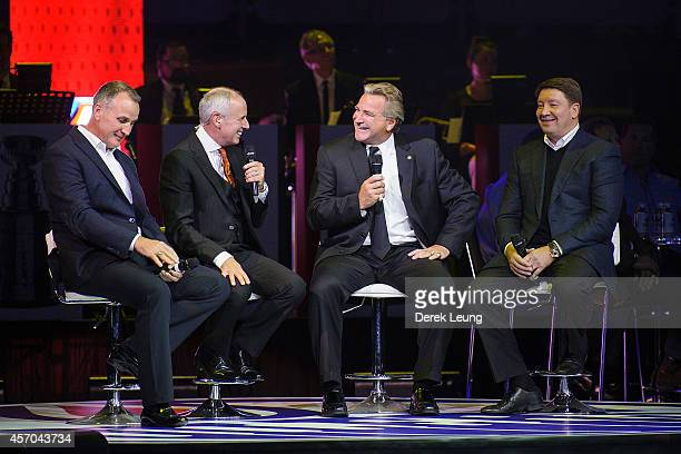 Paul Coffey Ron MacLean Glenn Anderson and Jari Kurri talk during the Edmonton Oilers Stanley Cup Reunion at Rexall Place on October 10 2014 in...