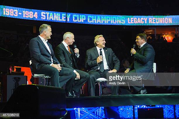 Paul Coffey Ron MacLean Glenn Anderson and Jari Kurri talk on stage during the Edmonton Oilers Stanley Cup Reunion at Rexall Place on October 10 2014...