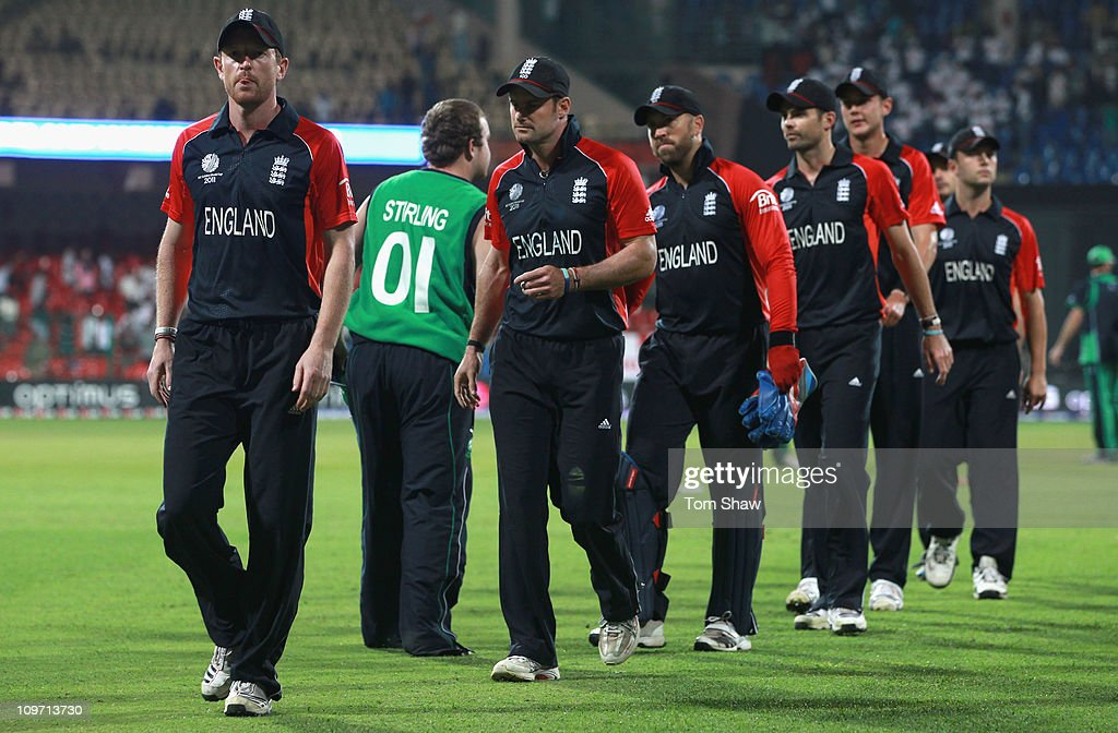 Paul Collingwood and Andrew Strauss of England and the rest of the team shake hands after losing the match during the 2011 ICC World Cup Group B match between England and Ireland at the M. Chinnaswamy Stadium on March 2, 2011 in Bangalore, India.