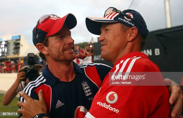 Paul Collingwood is congratulated by coach Andy Flower after the victory in The 5th One Day International gave England a sereis win against The West...
