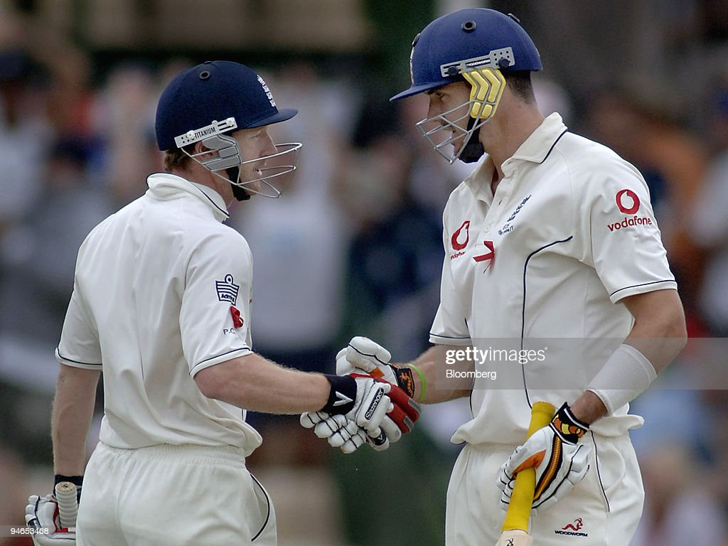 Paul Collingwood, left, is congratulated by team mate Kevin : News Photo