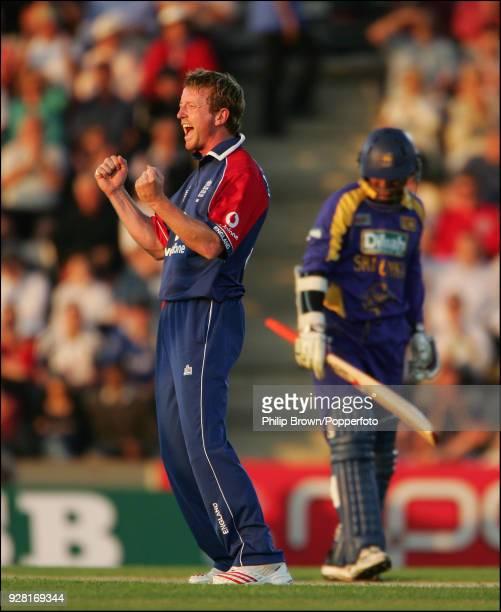 Paul Collingwood of England celebrates after taking the wicket of Sri Lanka batsman Kumar Sangakkara during the Twenty20 International between...