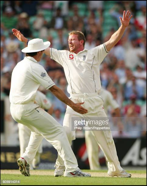 Paul Collingwood of England celebrates with Michael Vaughan after taking the wicket of Sourav Ganguly of India LBW for 37 runs during the 3rd Test...