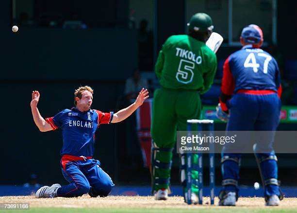 Paul Collingwood of England falls to his knees after a shot by Steve Tikolo of Kenya during the ICC Cricket World Cup Group C match between England...