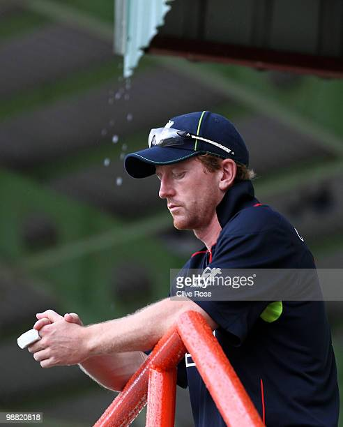Paul Collingwood of England looks on as the rain comes down during the ICC T20 World Cup Group D match between West Indies and England at the Guyana...