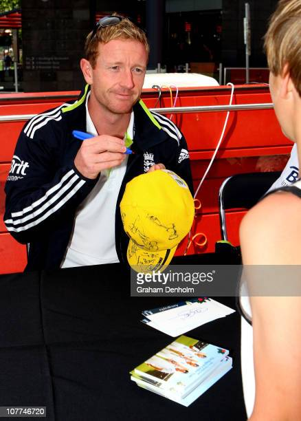 Paul Collingwood of England signs his autograph for a fan during an Ashes fan day at Queensbridge Square on December 23, 2010 in Melbourne, Australia.