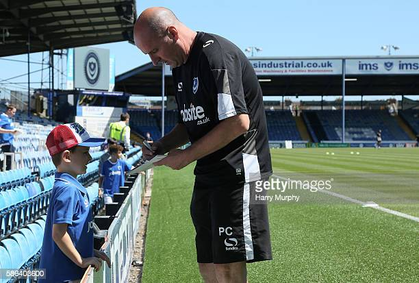 Paul Cook signs autographs ahead of the Sky Bet League Two match between Portsmouth and Carlisle United at Fratton Park on August 6 2016 in...