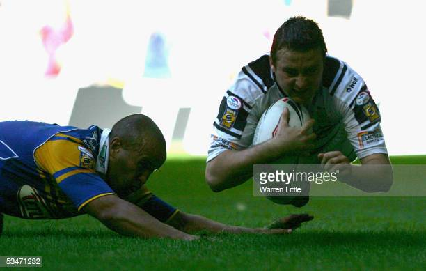 Paul Cooke of Hull dives over to score to the winning try during the Powergen Challenge Cup Final between Hull FC and Leeds Rhinos at the Millennium...