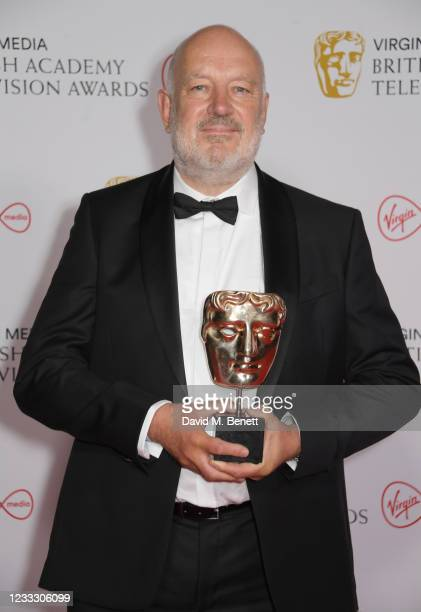 """Paul Cooper, accepting the Best Male Comedy Performance award on behalf of Charlie Cooper for """"This Country"""", poses in the Winners Room at the Virgin..."""