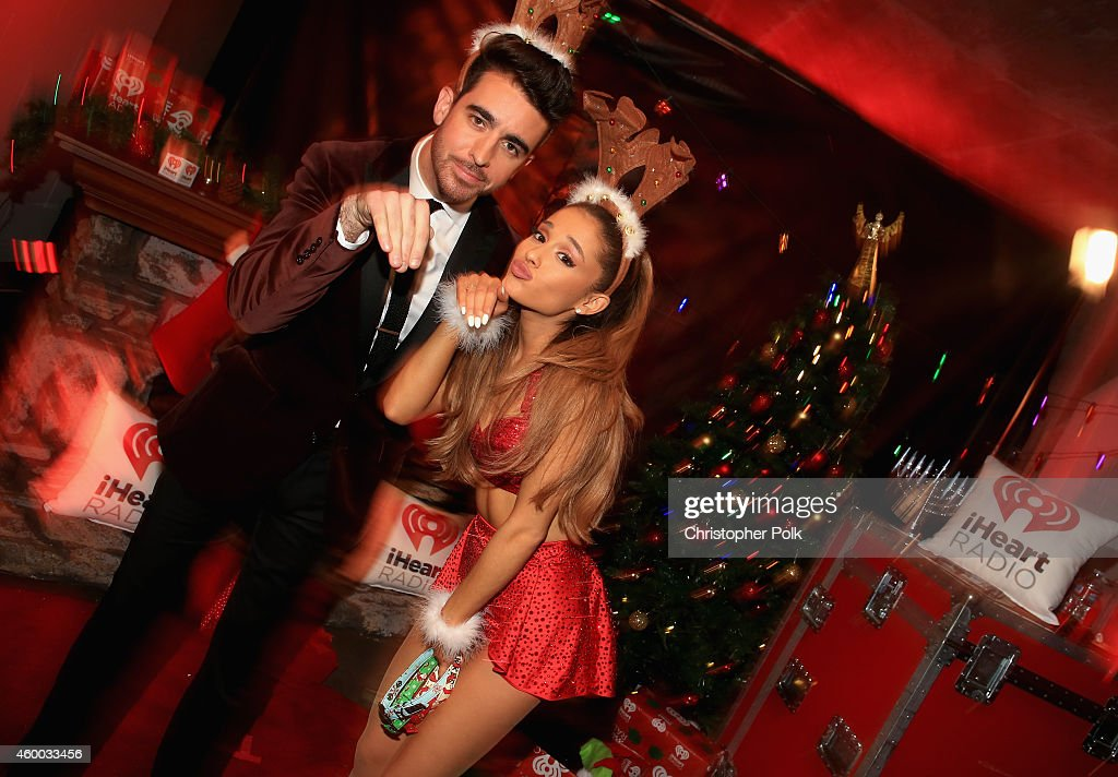 Paul Costabile (L) and singer Ariana Grande attend KIIS FM's Jingle Ball 2014 powered by LINE at Staples Center on December 5, 2014 in Los Angeles, California.