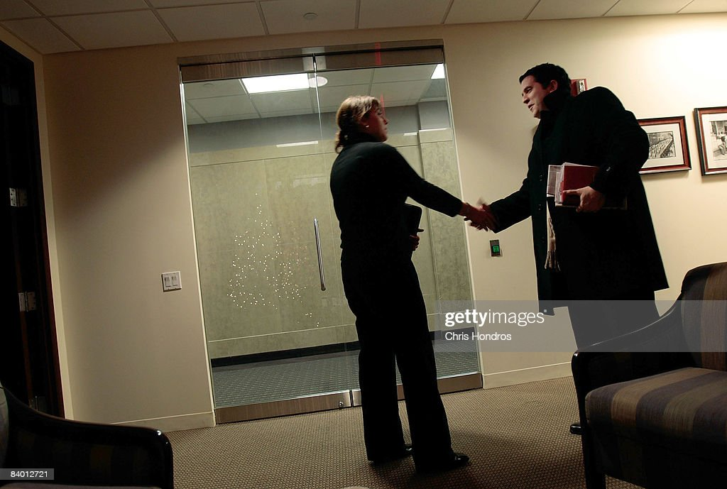 Paul Costiglio, a marketing and public relations professional (R), shakes hands with recruiter Julie Jarrett of the executive search firm Heyman Associates after a meeting December 12, 2008 in New York City. Costiglio, 35, was laid off from his marketeing job at The Partnership for a Drug-Free America last month, and is looking for a new position to support his wife and three children. 'I know there's a lot of competition out there right now' he says, so he's using networking clubs and job placement firms in his search for a new position.