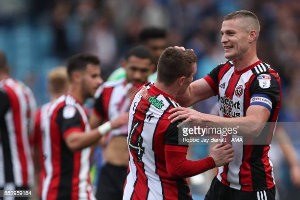 Paul Coutts of Sheffield United and John Fleck of Sheffield United celebrate at full time during the Sky Bet Championship match between Sheffield...